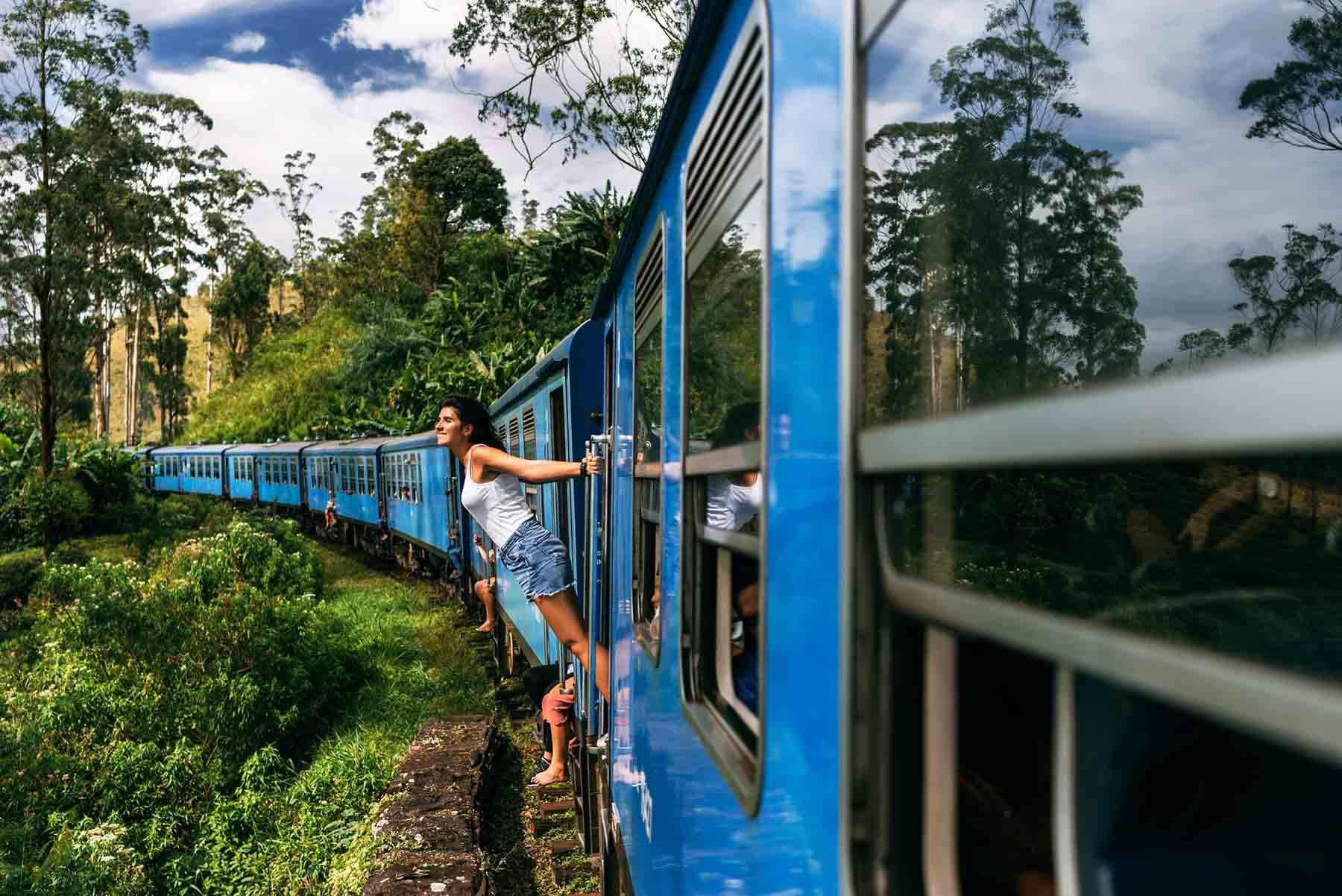 The girl travels by train to beautiful places. Beautiful girl traveling by train among mountains. Travel by train. Travelling to Asia. Trains Sri Lanka. Railway transport. Railway. Transport Asia